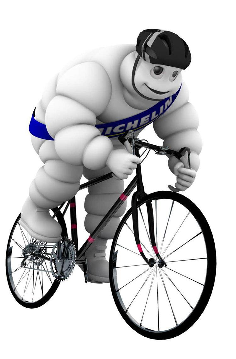 immagine del Bibendum con tanto di caschetto e bici da strada