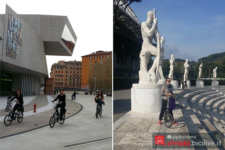Ciclisti pedalano al museo d'arte contemporanea MAXXI di Zaha Hadid e allo Stadio dei Marmi