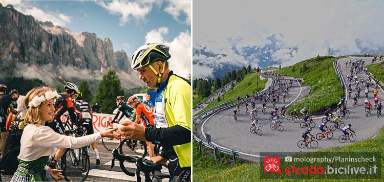 ciclisti percorrono i tornanti della Maratona dles Dolomites