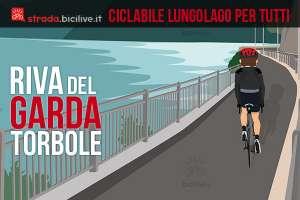 ciclista sulla ciclabile tra riva del garda e torbole